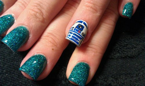 "Manicure Monday: Star Wars - R2-D2 I love that nail artist Krystina Kathryn decided to go with the ""one nail in a different color"" trend but with an R2-D2 twist! Awesome job."