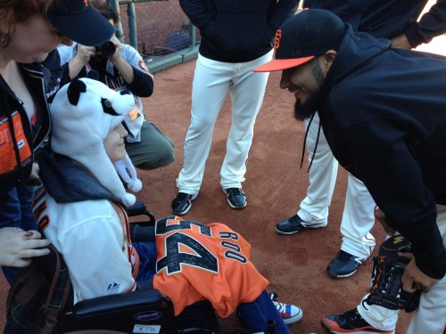 Yesterday's first pitch, Ariel, gets presented with a signed Giants Jersey from Sergio Romo with teammates Brandon Belt, Javier Lopez and Madison Bumgarner.