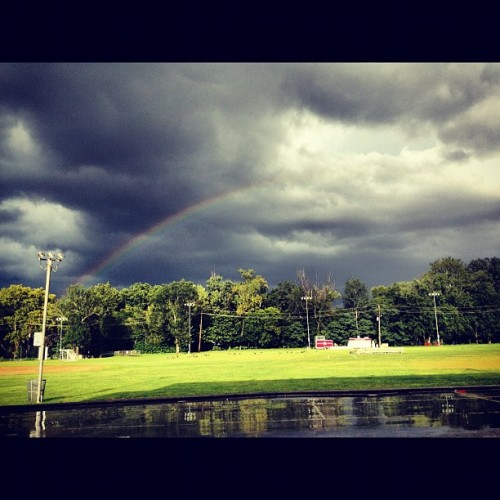 #rainbow #clouds #sky #rain #field #grass #storm #water #trees (Taken with Instagram)