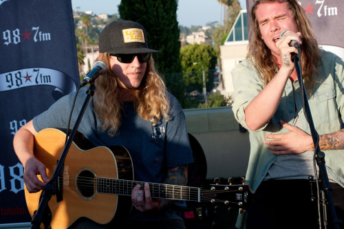 "Reggae/rock group Dirty Heads were the recent guests at 98.7-FM's Penthouse, an exclusive concert series hosted by Los Angeles-based radio station KYSR-FM at the historic Hollywood Tower in Hollywood, Calif. Before an intimate crowd, Dirty Heads performed an acoustic set including ""Lay Me Down,"" ""Spread Too Thin"" and ""Dance All Night."" Prior to the performance, Dirty Heads vocalist/guitarist Dustin ""Duddy B"" Bushnell and vocalist Jared ""Dirty J"" Watson participated in an exclusive interview with GRAMMY.com, discussing the influence of rap on their music, their current tour with Matisyahu and their new album, Cabin By The Sea, among other topics."
