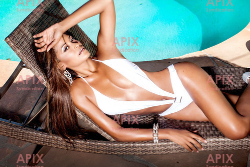 We have just received another brand new shoot of Claudia Jordan, who is the girlfriend of Larry Fitzgerald, the star wide receiver for the Arizona Cardinals.  Apart from being a popular American Football WAG, Claudia was a Barker's Beauty on The Price Is Right, briefcase model #1 on Deal Or No Deal, a contestant on The Celebrity Apprentice, and she featured in the movie Middle Men with Luke Wilson and Giovanni Ribisi.   These images are all model released, unpublished, and a behind-the-scenes video is available as well.  For a different look, we also have a sexy lingerie shoot of Claudia available.
