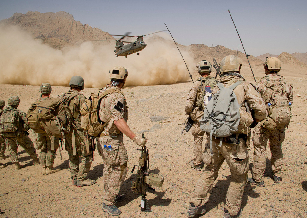 United States Navy SEALs  Afghan National Army Commandos from the 3rd Special Operations Kandak and coalition forces prepare to board a CH-47 Chinook helicopter after completing a patrol in Shah Wali Kot district, Kandahar province, Afghanistan, Aug. 12. ANA commandos partnered with coalition forces are currently conducting combat operations in order to disrupt insurgent safe havens and promote security in the region.