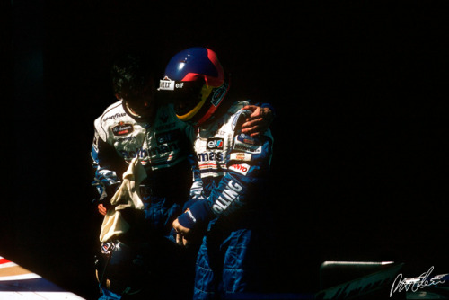 Damon Hill congratulating and consoling team mate Jacques Villeneuve after his maiden Grand Prix at Melbourne, 1996. Starting from pole position, the French-Canadian Indy 500 winner and son of former Ferrari hero Gilles Villeneuve, lead most of the race before a small off damaged the rear of his car, causing it to spill oil all over his close following team mate. To stop the car from completely failing all together, Villeneuve had to drop off the pace which allowed Hill to pass and take the first win of what would be a dominant season for the two Williams drivers. Naturally thrilled with a stunning debut where he outqualified and outpaced his esteemed and more experience team mate, Villeneuve was left deflated after failing to win due to a small mistake.