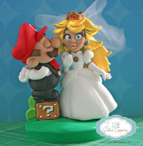 it8bit:  Mario & Peach handmade cake topper Created by Christina Patterson  Website || Facebook || Flickr  Hungry? xoxo