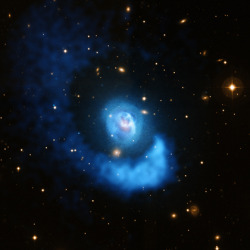 astronomer-in-progress:  Abell 2052: A Galaxy Cluster Gets Sloshed  Image credit: NASA/Chandra X-ray Observatory