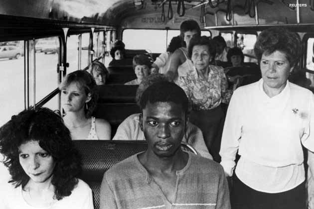 nevermindreal:  A black man rides a bus restricted to whites only, in Durban. In an act of resistance to South Africa's apartheid policies, riding a bus restricted to whites only, in Durban, South Africa 1986.