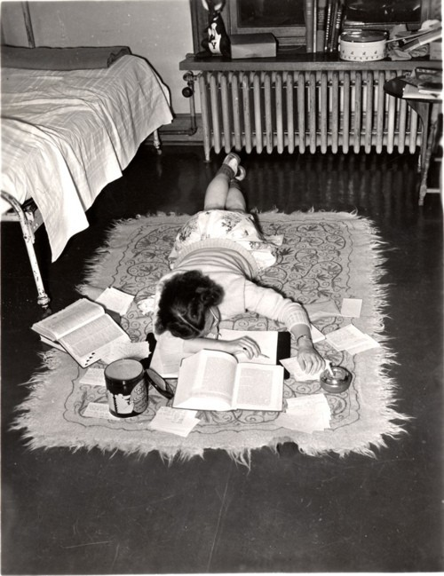 thisfemaleform:  theniftyfifties: A teenager does her homework on the floor, 1950s.  True Life.  On a yoga mat, full sized bed etc.