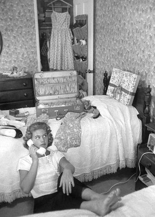 theniftyfifties:  A girl on the telephone in her bedroom, 1950s.