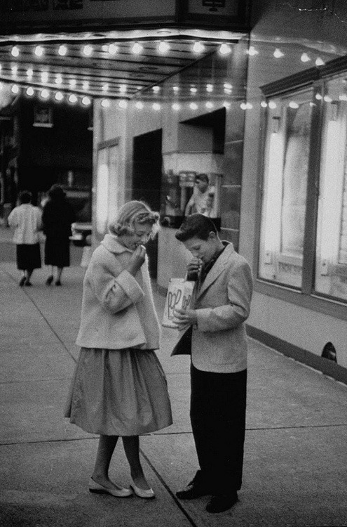 of-mice-and-mania:   Teenagers on a movie date night, 1957  aw i wish it was like this, its so cute, the girl is fully dressed, and the boy's pants aren't at his knees. and theyre not making out or having sex just aw