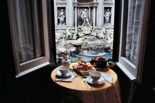 pfelps:  fe-licita:   The room with a perfect view - Rome  this kinda reminds me of my breakfasts in Venice but better because i didnt have the Trevi fountain in my view…  f  JV and I swore to each other that one day we'd live in one of the apartments in front of the trevi