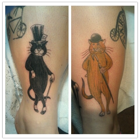 fuckyeahtattoos:  These are both of my cats done Edward Gorey style. I got the black one done first for my cat Mojo for his 10th birthday. I just got the second one for my cat Orange Cat. I love them so much. Done by Neil Worth at Forever Yours Tattoo Gallery in Douglasville, GA