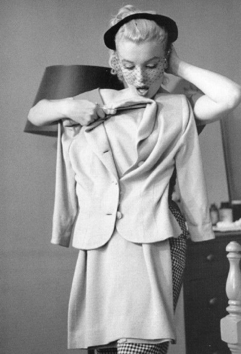"#Marilynettes ~ Marilyn Monroe deciding if this outfit for ""Niagara"" looks good. What do you think? [1952]"