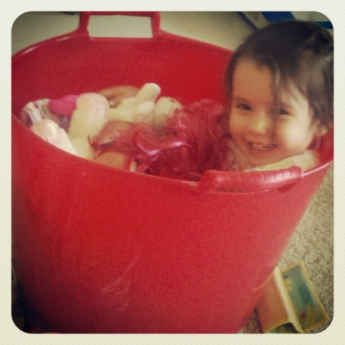 Naomi hopped in her toy bucket to watch cartoons (Taken with Instagram)