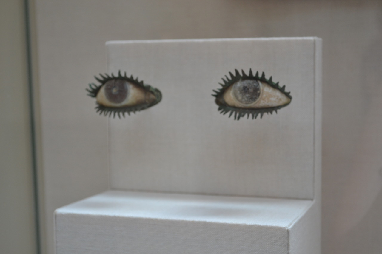 elleeh:  1991.11.3a, b Pair of eyes Bronze, marble, frit, quartz, and obsidian Probably Greek, 5th century B.C or later Greek and Roman statues were designed to give a colourful lifelike impression. Marble and wood sculptures were brightly painted, and bronze statues were originally a pale fleshlike brown. Lips and nipples were often inlaid with copper, and teeth with silver. Eyes were usually made separately and set into prepared sockets. This pair, designed for an over-lifesize statue, gives a sense of potent immediacy that ancient sculpture could convey. Greek and Roman Statues were designed to give a colourful lifelike impression. Marble and wood sculptures were originally a pale fleshlike brown. Lips and nipples were often inlaid with copper, and teeth with silv