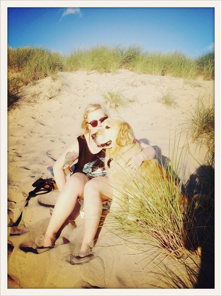 having a romantic moment with my dog on the beach. I LOVE HIM.