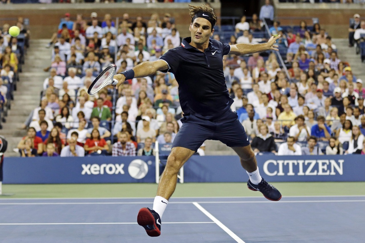 "Roger Federer closed the night on Monday with a 1-hour, 34-minute dispatching of Donald Young and stayed in the mix for his sixth U.S. Open title.Federer, a loser to Novak Djokovic in the semi-finals the last two years, is seeded first for the 23rd time at a Grand Slam, breaking the record he shared with Pete Sampras.""Being back in New York as world No. 1, it's crazy, and I really, really enjoy it,"" Federer said.Photo: Charles Krupa/The Associated Press"