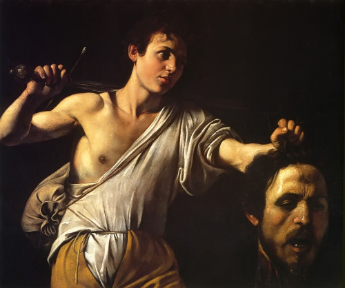 nomadintransit:  Caravaggio - David Showing Goliath's Head  Did you know: Goliath's face there is actually Caravaggio's self-portrait!