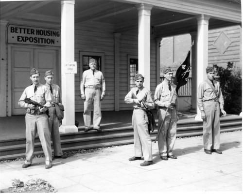 "Home Guard Defending ""Last National Bank"" during maneuvers, Minnesota State Fairgrounds, September 1941 Men in the photo from left to right: John Reed, Sgt. H.W. Lorentz, R.H. Tackenberry, Leo Ryan, Claude Rinerson and C.R. Hoff."