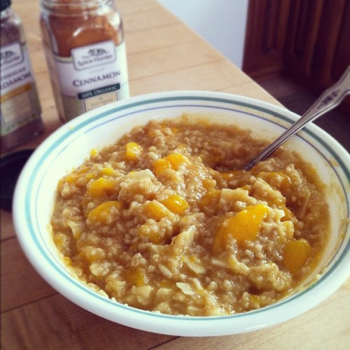 Mango Coconut Oatmeal spiced with Cinnamon and cardamom. What a filling breakfast!   (Taken with Instagram)