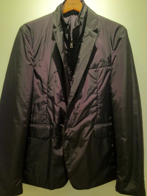 This nylon Prada jacket has appeared in many colors and variations over the last few years.  We have the simple black with inside zip-up vest this year.