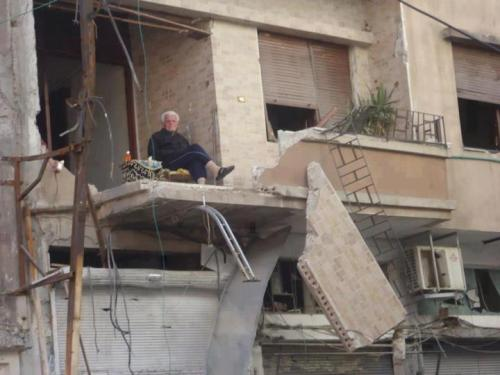 loveinthetimeofdiarrhea:  Syrian man drinking tea after his house was bombed.
