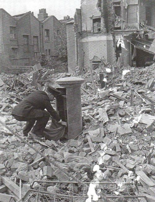 do-not-tumble:    A British Postman on his rounds, London Blitz 1940