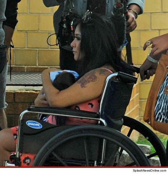 FIRST PHOTO OF SNOOKI'S HAIRY BABY!!! You can't see much of baby Lorenzo's face … only the top of his head … which appears prime for gobs of gel and grease.
