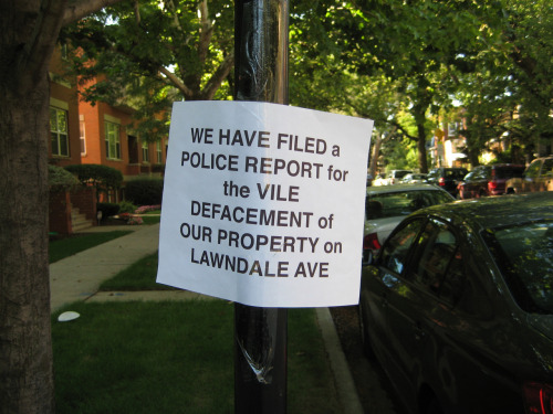 One of about six notices spotted on a block in Chicago's Avondale neighborhood. It's not clear what defacement they are commenting on but someone's anger is pretty apparent.
