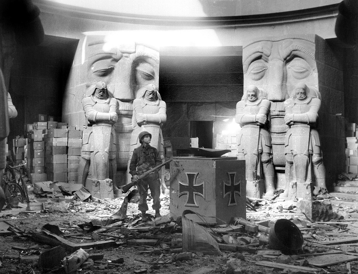 A U.S. soldier stands in the middle of rubble in the Monument of the Battle of the Nations in Leipzig after they attacked the city on April 18, 1945. The huge monument commemorating the defeat of Napoleon in 1813 was one of the last strongholds in the city to surrender. One hundred and fifty SS fanatics with ammunition and foodstuffs stored in the structure to last three months dug themselves in and were determined to hold out as long as their supplies. American First Army artillery eventually blasted the SS troops into surrender.