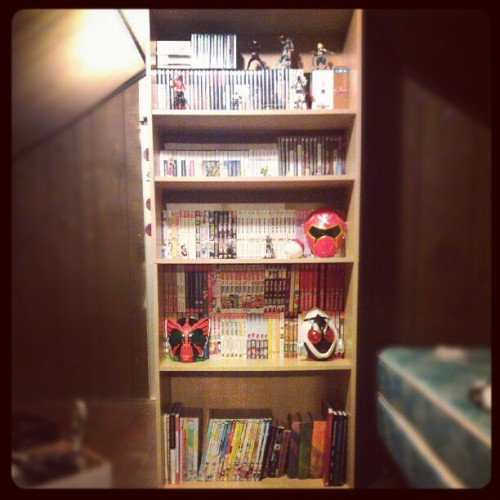 New bookshelf yes. #bookshelf #books #shelf #manga #kamenrider #ooo #fourze #kaizokusentaigokaiger #gokaiger #supersentai #videogames #gaming  (Taken with Instagram)