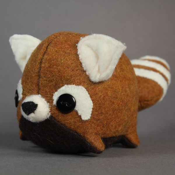 Rusty Red Panda Smudge by Paisley Fawn If I weren't so damn masculine I'd squeal with delight at the sight of this red panda plush by Paisley Fawn. They're all hand made by Paisley herself, and she gives each plushy some unique features so that no two are exactly the same. Get one at Rotofugi for $34.