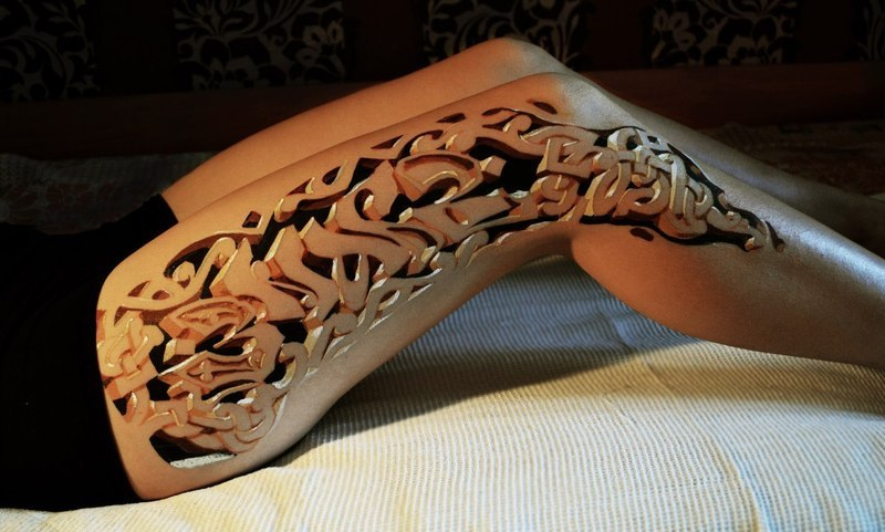 fuckyeahtattoos:  This is a 3D Tattoo done on a ladies leg. Although I uploaded the image I would appreciate it if you fine people would actually reblog the post itself that I made last night from here http://mrcheyl.tumblr.com/post/30424397113/3d-leg-tattoo-sick . It seems to be garnering a lot of attention as many people have never seen it before.   Damn