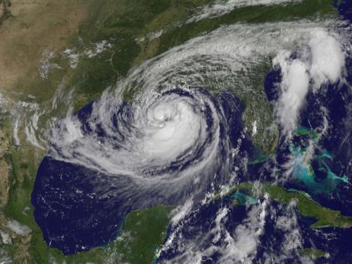 Isaac Churns in the Gulf This visible image of Tropical Storm Isaac taken from NOAA's GOES-13 satellite shows the huge extent of the storm, where the eastern-most clouds lie over the Carolinas and the western-most clouds are brushing east Texas. The image was captured on Tuesday, Aug. 28, 2012 at 10:25 a.m. EDT. Image Credit: NASA GOES Project