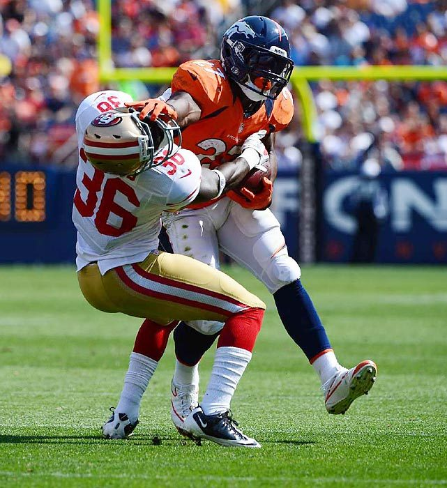 Denver's Knowshon Moreno puts a devastating stiff arm on San Francisco's Michael Thomas during their preseason game on Sunday. The 49ers won 29-24. (John W, McDonough/SI) GALLERY: Leading Off - Pictures of the Week