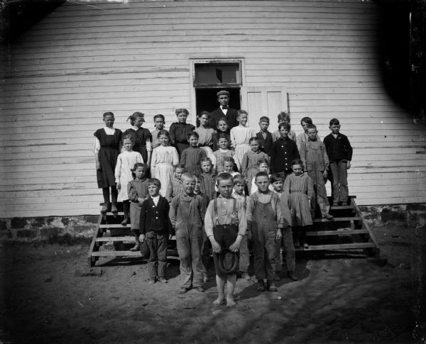 Students and teacher, Black River Falls, Wisconsin. Photo by Charles Van Schaick. via: Wisconsin Historical Images, WHi-53272 see more: Charles Van Schaick's photographs of the Black River Falls area from the collections of the Wisconsin Historical Society.