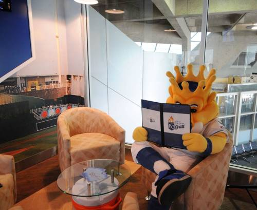 Sluggerrr checks out the menu at the newly opened Top of the Crown Grill located in Terminal B at the Kansas City International Airport. The restaurant pays homage to the rich history of the Royals.