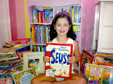 Congrats to six-year-old Isabella Policarpo, the top child summer reader in Staten Island! Isabella read 413 books, most from her local Todt Hill-Westerleigh branch library. She and other top summer readers will get to step on the field at this afternoon's Yankees game and meet outfielder Curtis Granderson. Hats off to all our summer readers!! Photo courtesy Milena Policarpo and Staten Island Advance.