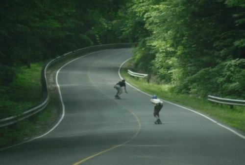 Jeremy Ross and Noah Tsouprake flying down a serene western mass road