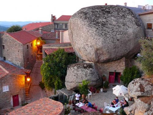 "Ever heard of a village built around boulders? There's one in Portugal! The town of Monsanto has gigantic boulders for centerpieces. Known as the ""most Portuguese"" of all Portugal towns, Monsanto has a population of 828!"