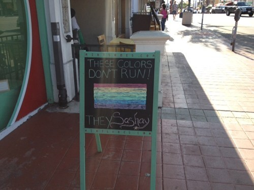 Gay-Friendly Sidewalk Sign of the Day: Spotted outside Mintshoes.com in Hillcrest, CA. [hypervocal]