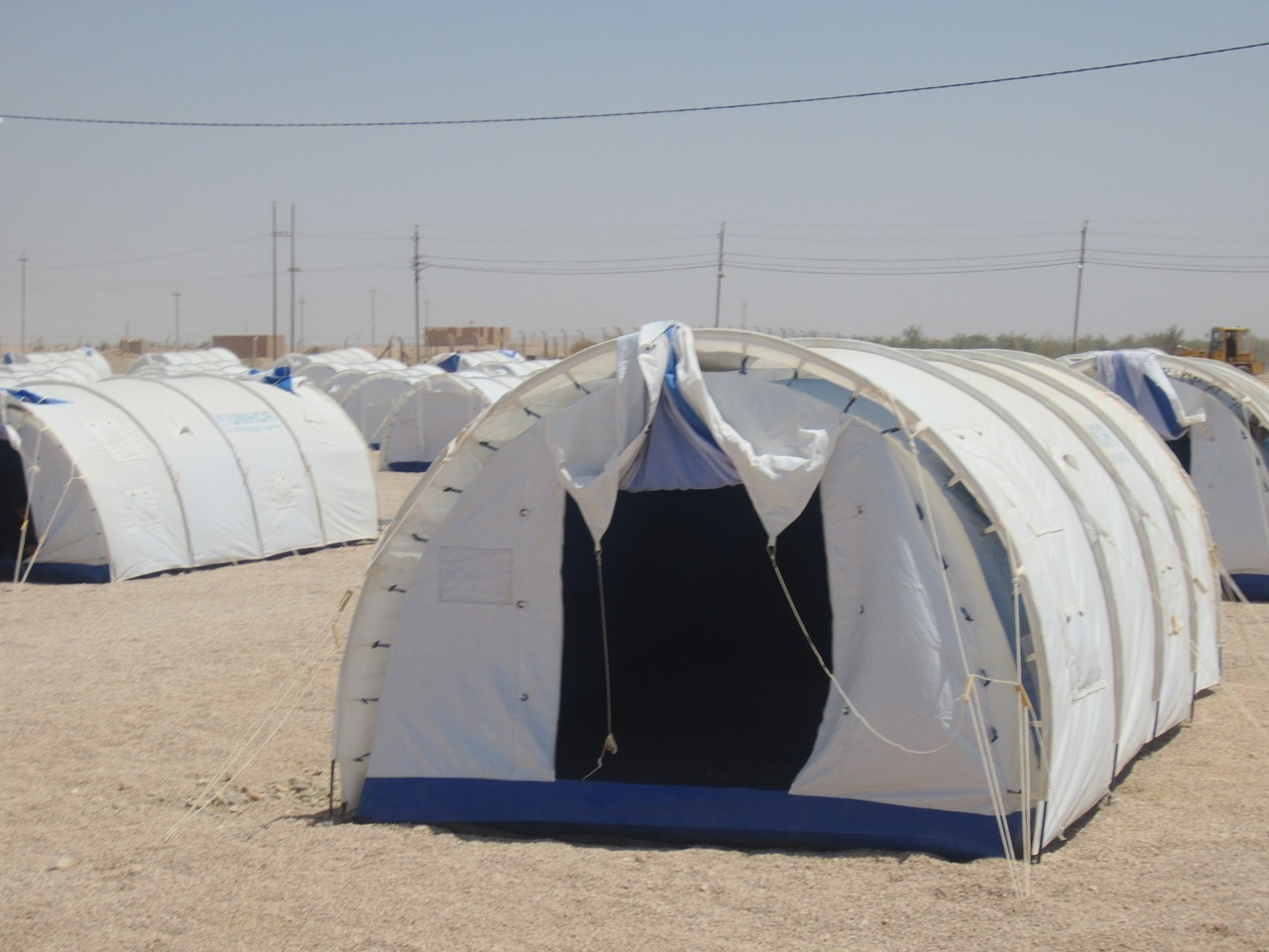 humanrightswatch:  A UNHCR tent camp in al-Qaim, Iraq. Syrian refugees have been gradually moved there since mid August from schools in al-Qaim where the Iraqi government had been confining them since late July. As of August 28, over 2,000 refugees were in the camp, and close to 2,000 remained in schools, guarded by the Iraqi police and military and not allowed to leave. August 9, 2012. Read more after the jump. Photo © 2012 Human Rights Watch