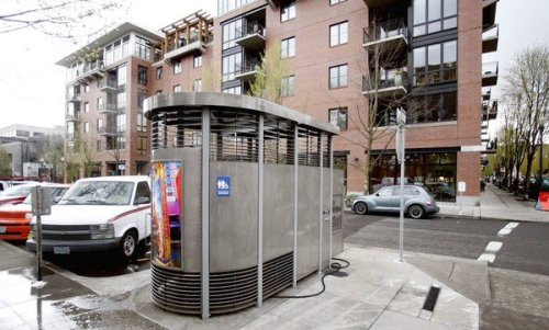 latimes:  A sustainable public toilet? Thanks, Portland.  Portland officials say the Loos buck many of the conventions of public toilets: They are not installed in out-of-the-way spots where no one will see them. Rather, most are placed along sidewalks in full public view. They are not self-cleaning, but are made of prison-grade steel with plumbing so basic that they are almost impossible to damage, and a twice-a-day check by maintenance staff seems to keep them in good working order. The only water faucet is on the outside, making customers less likely to linger for hair-washing or laundry. Perhaps most important, they aren't all that private. Louvered slats from foot level to knee level and again just above head level make activity inside somewhat visible, and audible, to passersby.  Photo credit: Rick Bowmer / Associated Press