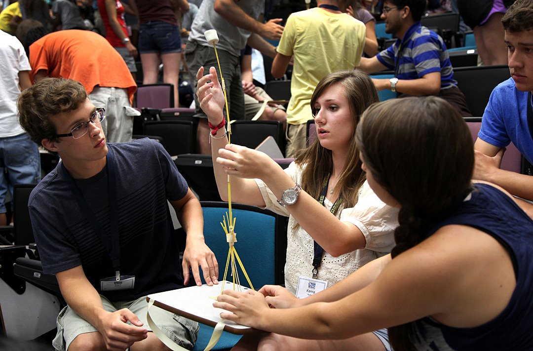 Incoming freshmen compete to build the highest possible tower out of pasta, tape and a single marshmallow that needs to stay on top of the structure during the Design Immersion challenge on Wednesday, August 29th, 2012. Photo by Marcin Szczepanski, University of Michigan, College of Engineering, Multimedia Producer