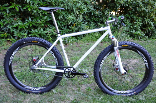 Specs: Frame: 1994 Rhygin Ra, 2012 Circle A Cycles Seat and Chain Stays Fork: White Brothers Loop Hubs: Chris King Spokes: Sapim CX-Ray Rims: ENVE XC Quick Release (Rear): Cook Bros. Racing Tires: Continental Trail King 2.4 Pedals: Shimano XTR Crankset: White Industries ENO Chainring: White Industries 34T Chain: SRAM Cog: Chris King 18T Bottom Bracket: White Industries Titanium Handlebars: Black Sheep Titanium Grips: ODI Stem: Firefly Titanium Headset: Chris King Titanium NoThreadSet Brakes: Avid BB7 Brake Levers: Paul Components Love Lever Compact Saddle: Sella Italia SLR Seat Post: Firefly Titanium Head Badge: Jen Green Place of Origin: Charlestown, MA / Providence, RI