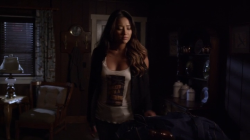 "Emily Fields (Shay Mitchell) wearing an awesome ""I walked with a zombie"" top. ""Pretty Little Liars"" 3x12 - The Lady Killer. The print on the top obviously refers to the 1943 movie by Jacques Tourneur."