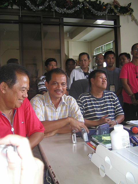 "The candidates we came to support in 2009: Sulpicio Roco; Sabas ""Abang"" Mabulo; Jess Robredo. (Flickr.) From Dios Mabalos, Jess, ""Proud to be a Nagueño"" By Soliman M. Santos Jr.  (MindaNews, August 26, 2012) Naga will never be the same again. Much of the story of Robredo's brand of local governance has been told and is being (re)told, with a vengeance, in the wake of his untimely passing. And we thus continue to learn more from him, from his leadership, and from his character. My own first personal encounter with Jess was as a cause-oriented peace advocate engaging a local official during his first few months as Mayor in 1988. Our non-governmental coalition, the Hearts of Peace (HOPE), shepherded then by the late Nagueña ""Mommy Jean"" Llorin, initiated a largely symbolic ""people's declaration"" of Naga City as a ""Zone of Peace, Freedom and Neutrality"" (ZOPFAN) during the Peñafrancia Fiesta in September 1988. This peace zone was basically an assertion of the people's right to peace, particularly from the armed hostilities between the AFP and the NPA. Jess gave us his moral and, quite importantly, political, support for this people's initiative, which mayoral support, in the final analysis, was indispensable for this initiative to have a fighting chance at all.  The Naga peace zone initiative at that time tended to generate resistance from the security sector, especially the military (which was already in ""total war"" mode as declared by then President Cory Aquino after the collapse of the GRP-NDF peace talks in 1987), and even the local Catholic Church hierarchy. Both sectors were gripped by the scare that the ""Reds"" were taking advantage of, if not behind, the initiative. Ironically, the rebel CPP-NPA-NDF would later issue its national-level policy against peace zones which it viewed as counter-insurgency. So, one could imagine that the support he gave to the initiative took a certain amount of courage, boldness or daring on the part of Jess. He was then a very young (30-year old), first-time Mayor whose then Lakas ng Bansa group had a minority of only two against the big majority of eight from the opposition Cory Coalition group in the City Council of a city that was long a bastion of Catholic conservatism. Jess thus early on reflected a brand of leadership that was open to new ideas and initiatives, to experiment, and even to take risks, whether of a political or security nature, but with the remarkable down-to-earth people skills to win over support for his programs.  The risks for Jess with his support for the Naga peace zone were underscored by the fact that it was actually the country's first ever peace zone, still an experimental concept. It may not have fully developed or been sustained here but it was an early example of concepts that spread to and were replicated in many other places. This was most notably in the case of peace zones in Central Mindanao, with a quite different (GRP-MILF) armed conflict context and more than a decade after the Naga peace zone became dormant. This was therefore just one of the earlier of many other Robredo-led Naga initiatives that would spread and be replicated elsewhere. Fr. Nelson Tria, himself a former Chairperson of another such initiative, the Naga City People's Council, in his homily at a mass for Jess lying in state at the Archbishop's Palace, described those initiatives as ""not just causing ripples but making waves"" – if I may add, uncannily like his plane crash (and death) at sea did, literally and figuratively.  A number of these Robredo-led Naga initiatives are documented and analyzed in the annals of the Galing-Pook awards for excellence in local governance, and in a growing number of academic studies, notably from foreign universities. And while Jess was not the writing-type like Rizal, he does have a book about it all, but which is not so well known — Making Local Governance Work: The Naga City Model, published by the city government in 2003 as a selection mainly of his papers delivered before various national and international forums. This obscure book, if reprinted, might now become a posthumous national bestseller, given our better appreciation for what we have just lost."