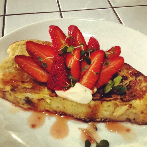 Vanilla French toast with pepesaya mascarpone, fresh strawberries & blood orange syrup. At the Sourced Grocer.