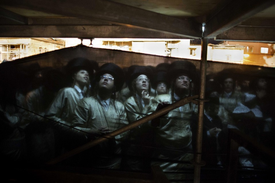 Ultraorthodox Hasidic Jewish people stood behind a curtain during the wedding of a rabbi's granddaughter in Jerusalem's Mea Shearim neighborhood Tuesday. Menahem Kahana/Agence France-Presse/Getty Images