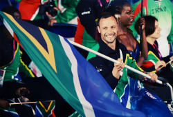 olympicsusa:  Oscar Pistorius leads Team South Africa into the Olympics Stadium at the 2012 London Paralympics Opening Ceremony Photo by Gareth Copley