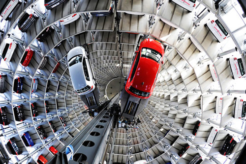 thekhooll:  Volkswagen Parking Lot Towers Spanning approximately 16 stories, two silos are used as a kind of temporary vertical parking lot at Volkswagen's production facility and Autostadt visitor attraction in Wolfsburg, Germany.